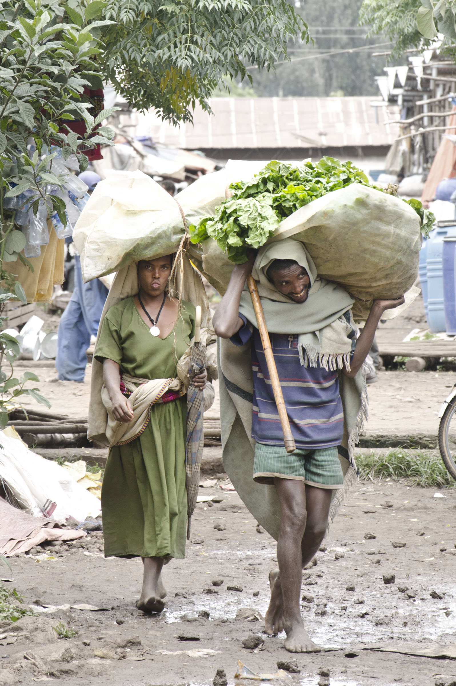 Bahir Dar, Ethiopia couple carry goods from market
